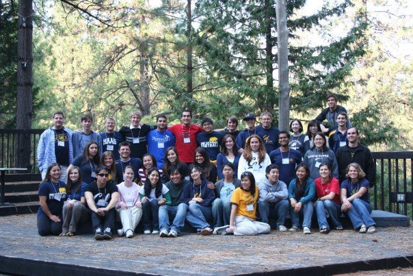 Fall 2007 retreat group picture on wooden stage in the forest.